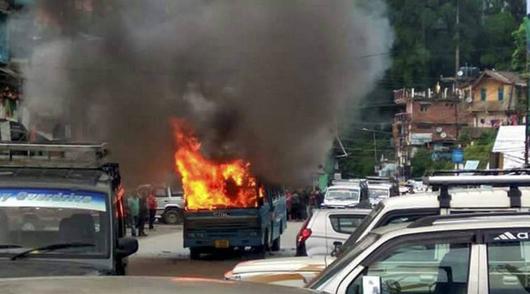 Darjeeling : A  state-government bus in flames after it was torched by Gorkha Janmukti Morcha (GJM) supporters in Darjeeling on Thursday. PTI  Photo (PTI6_8_2017_000236B)